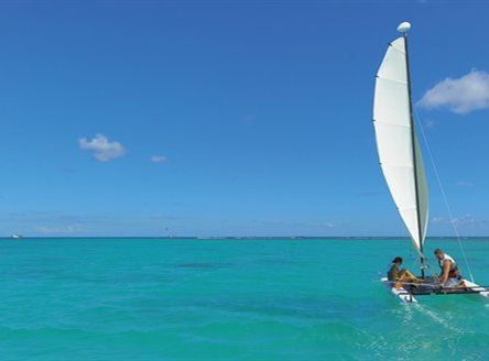 Many water sports at Trou aux Biches include sailing